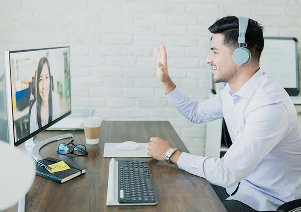 image of a man and woman participating in a teleconference