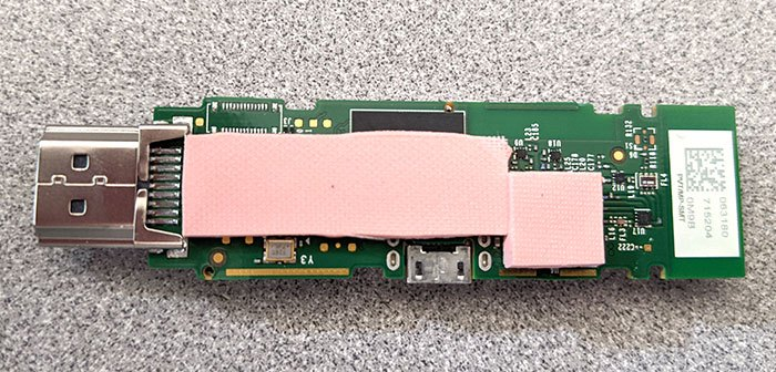 a view of the bottom of the Amazon Fire TV Stick PCB with a pink cushioing pad