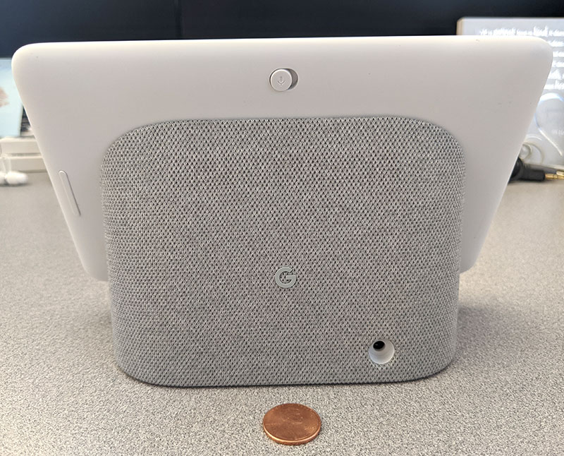 photo of the Google Home Hub back side with a penny for scale