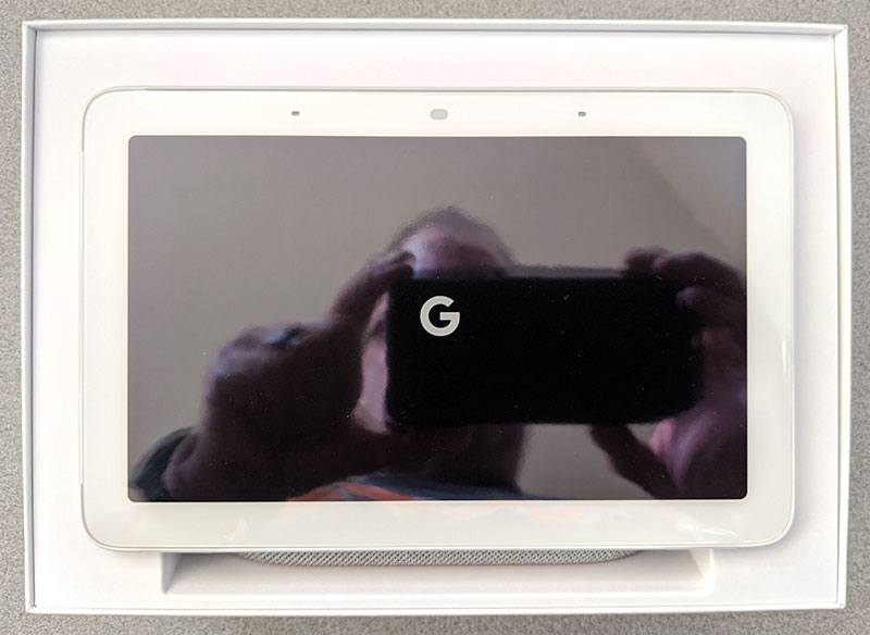 photo of the Google Home Hub in box with its clear protective sheet