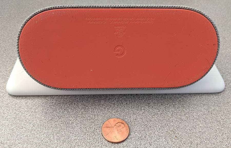 photo of the Google Home Hub's rubber foot with a penny for scale
