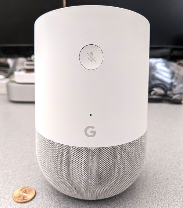 photo of the Google Home smart speaker back with a penny for scale