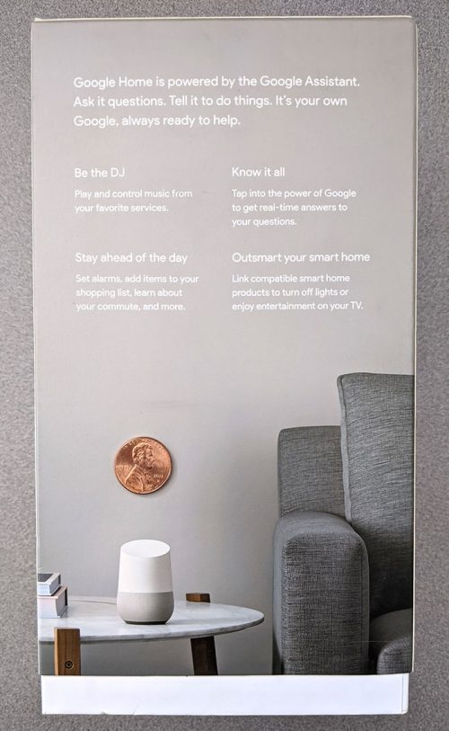 photo of the back of the Google Home smart speaker box with a penny for scale