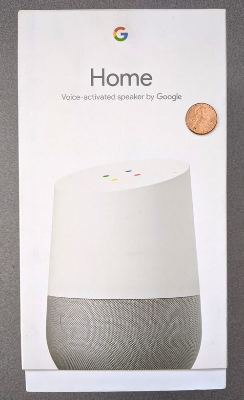 photo of the front of the Google Home smart speaker box with a penny for scale
