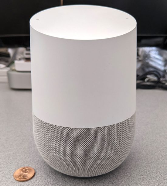 photo of the Google Home smart speaker front with a penny for scale