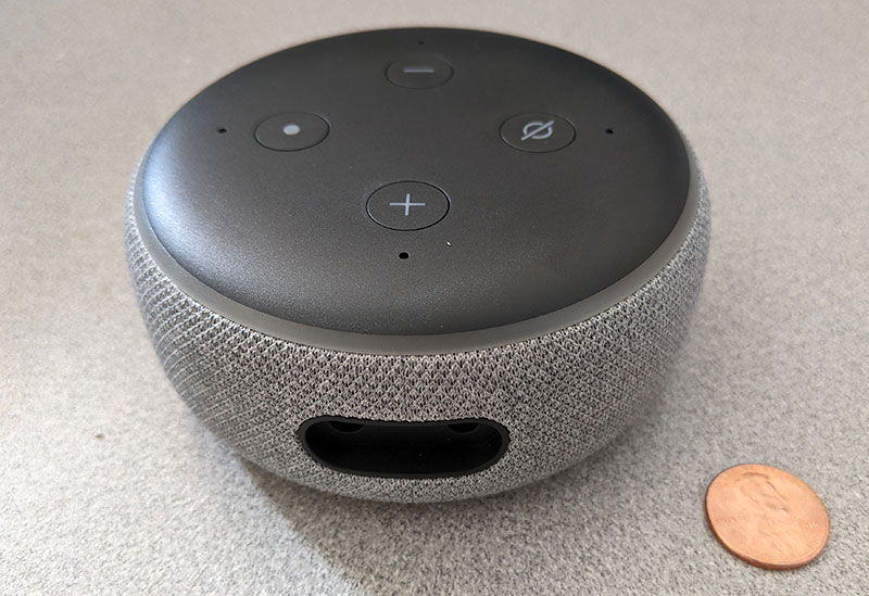 photo of the Amazon Echo Dot unboxed with a penny for scale