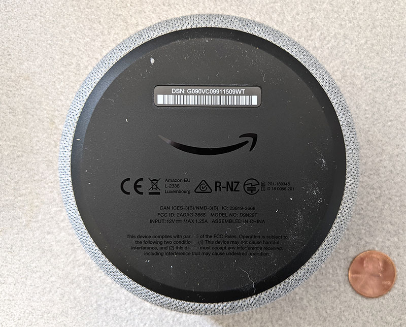 photo of bottom of the Amazon Echo Dot with a penny for scale
