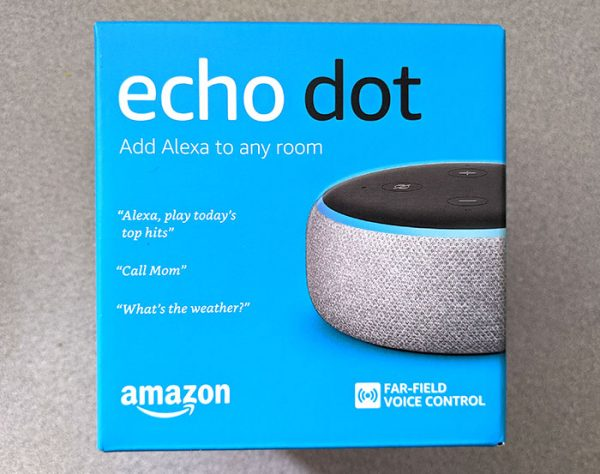 photo of the front of the Amazon Echo Dot box on a gray tabletop