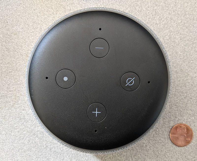 photo of the top buttons on the Amazon Echo Dot with a penny for scale